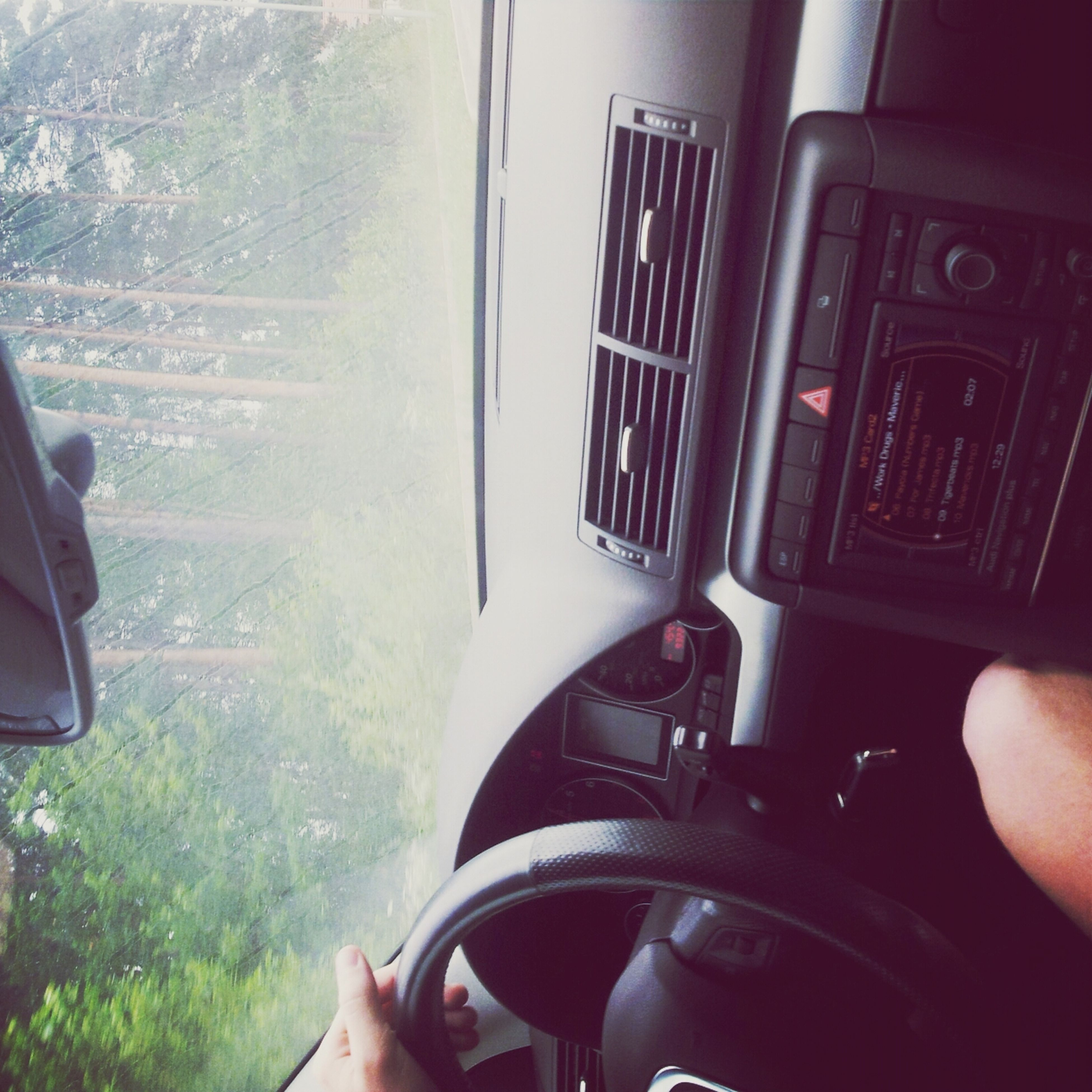 person, part of, cropped, lifestyles, personal perspective, leisure activity, holding, unrecognizable person, transportation, men, mode of transport, vehicle interior, indoors, technology, human finger, car
