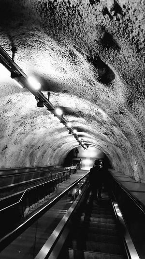 Tunnel Transportation Indoors  No People Day Architecture Saklimedia Stairs Men One Person Eyeemphoto Bnwphotography Bnw_life Monochrome Photography City Life Building Exterior Underground Station  Subway Station Built Structure Lights Light And Shadow Black And White Friday EyeEmNewHere