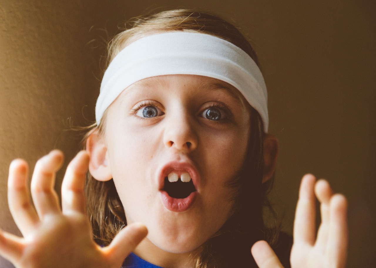 Active Animated Blue Eyes Boy Childhood Elementary Age Excited Excitement Fingers Hand Hands Hands Up Handsome Happy Headband Headshot Mouth Open One Person Portrait Real People Speaking Talking