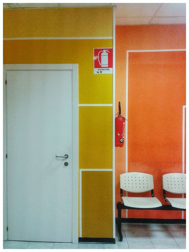 """Estintore"". Fire Extinguisher Estintore Safety Signs Safety Sign Waiting Room Corner Interior Design Yellow Orange Color Chairs Hospital Evangelico Mobile Photography S3mini & Camerazoomfx in HDR shooting mode ( Bracketing). Snapseed"