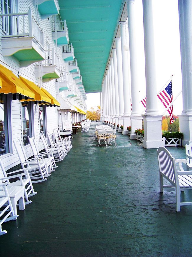GRAND HOTEL PORCH MACKINAW ISLAND, MICHIGAN USA- One of my favorite places! Architectural Column Architecture Building Column Flag From My Point Of View Front Porch Grand Hotel Hotel Hotel View In A Row Showcase June Mackinaw Island Michigan Porch Relaxing Moments Rocking Chairs Through My Eyes Travel Destinations Vacation Vacation Destination