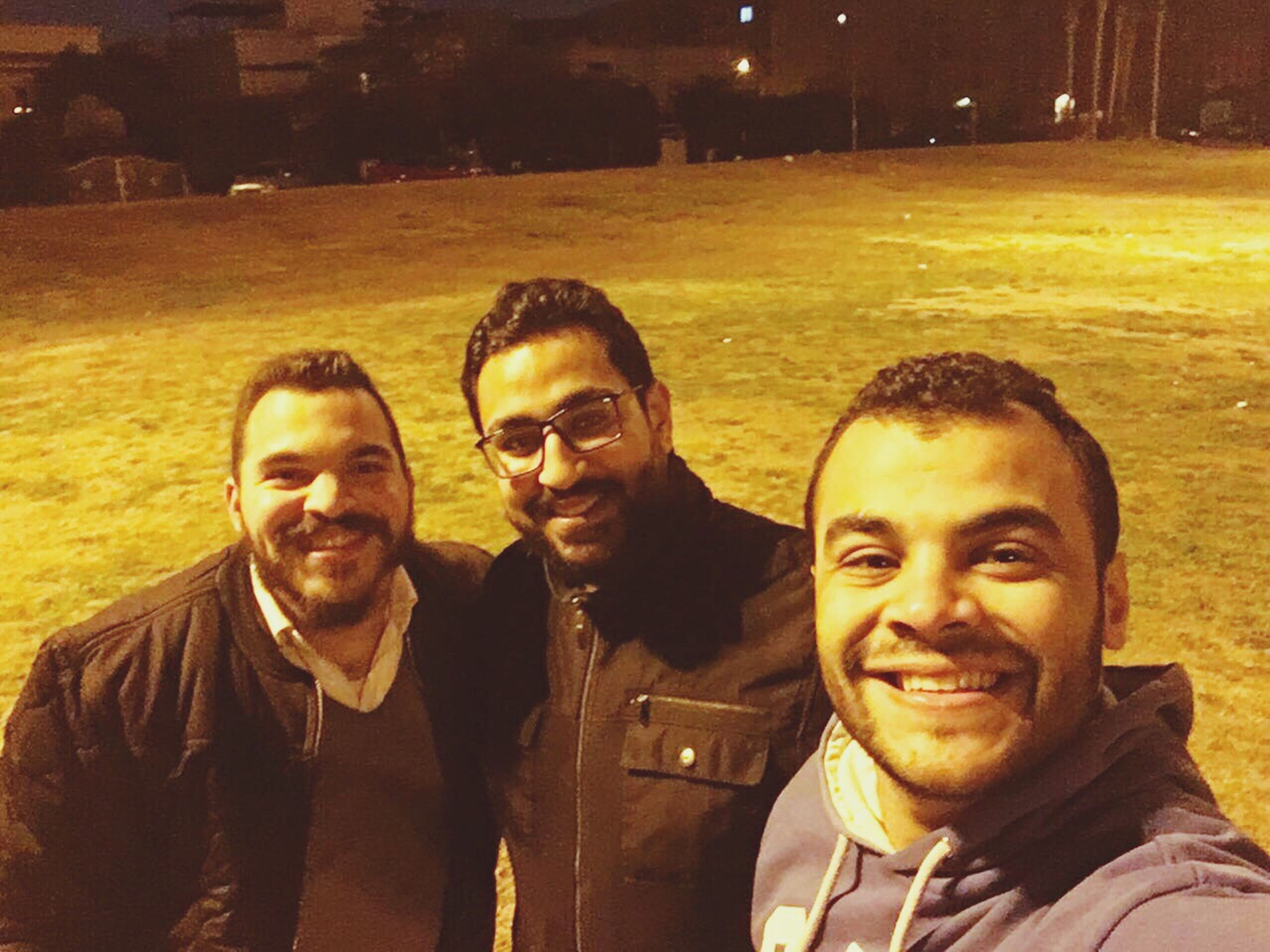 friendship, smiling, lifestyles, portrait, looking at camera, fun, selfie, happiness, men, city, outdoors, togetherness, young adult, people, adult, young women, cheerful, adults only, only men, day, human body part