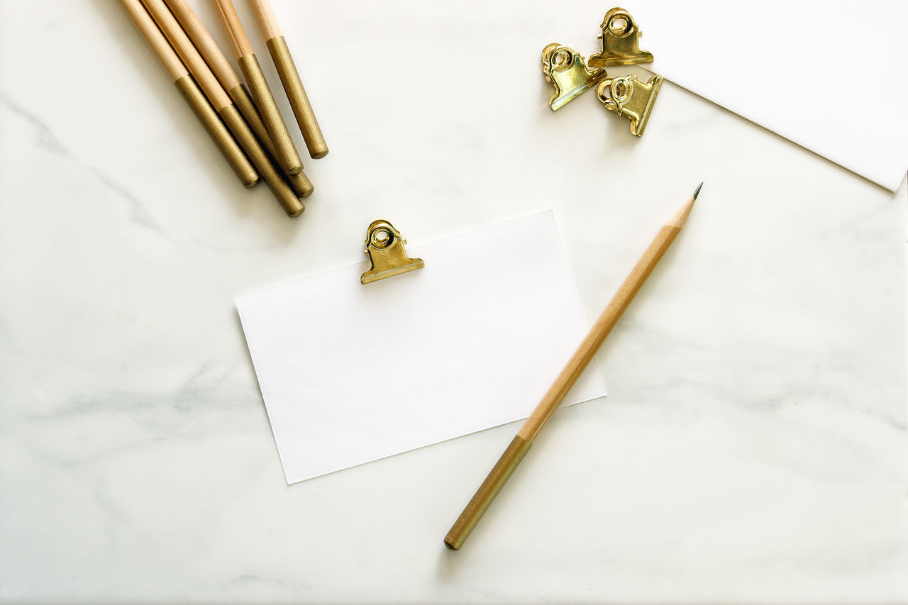 Note taking Desk Top Gold Gold Colored Marble Modern No People Note Taking Office Office Supplies Outdoors Over Head Paper Simple Study White Background Work