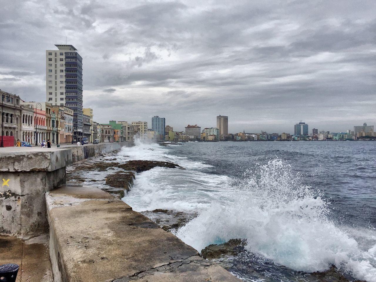 Waves Splashing Towards Retaining Wall Against Cloudy Sky