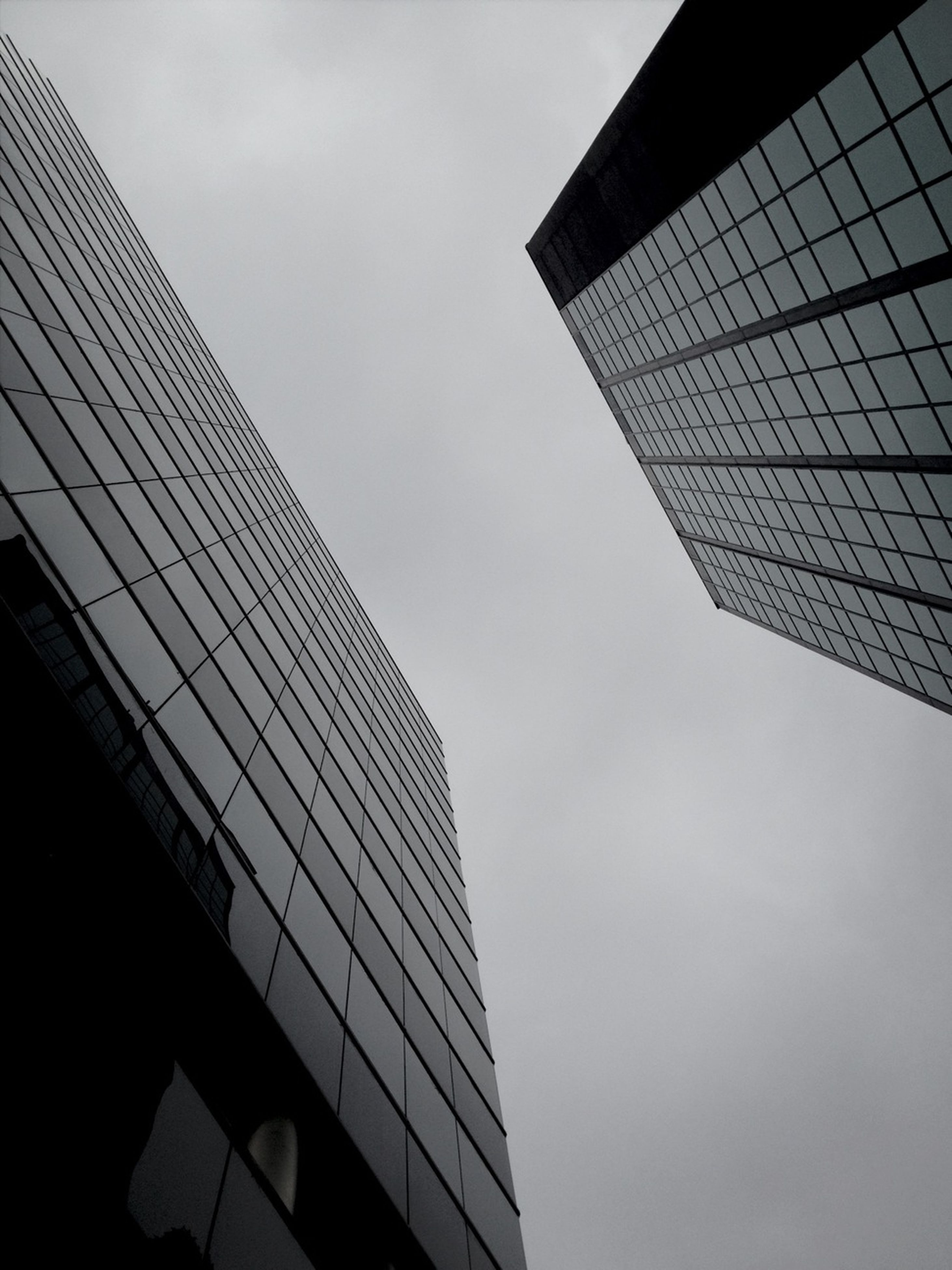 architecture, building exterior, built structure, low angle view, modern, skyscraper, office building, tall - high, city, tower, sky, glass - material, building, reflection, tall, day, capital cities, outdoors, city life, no people
