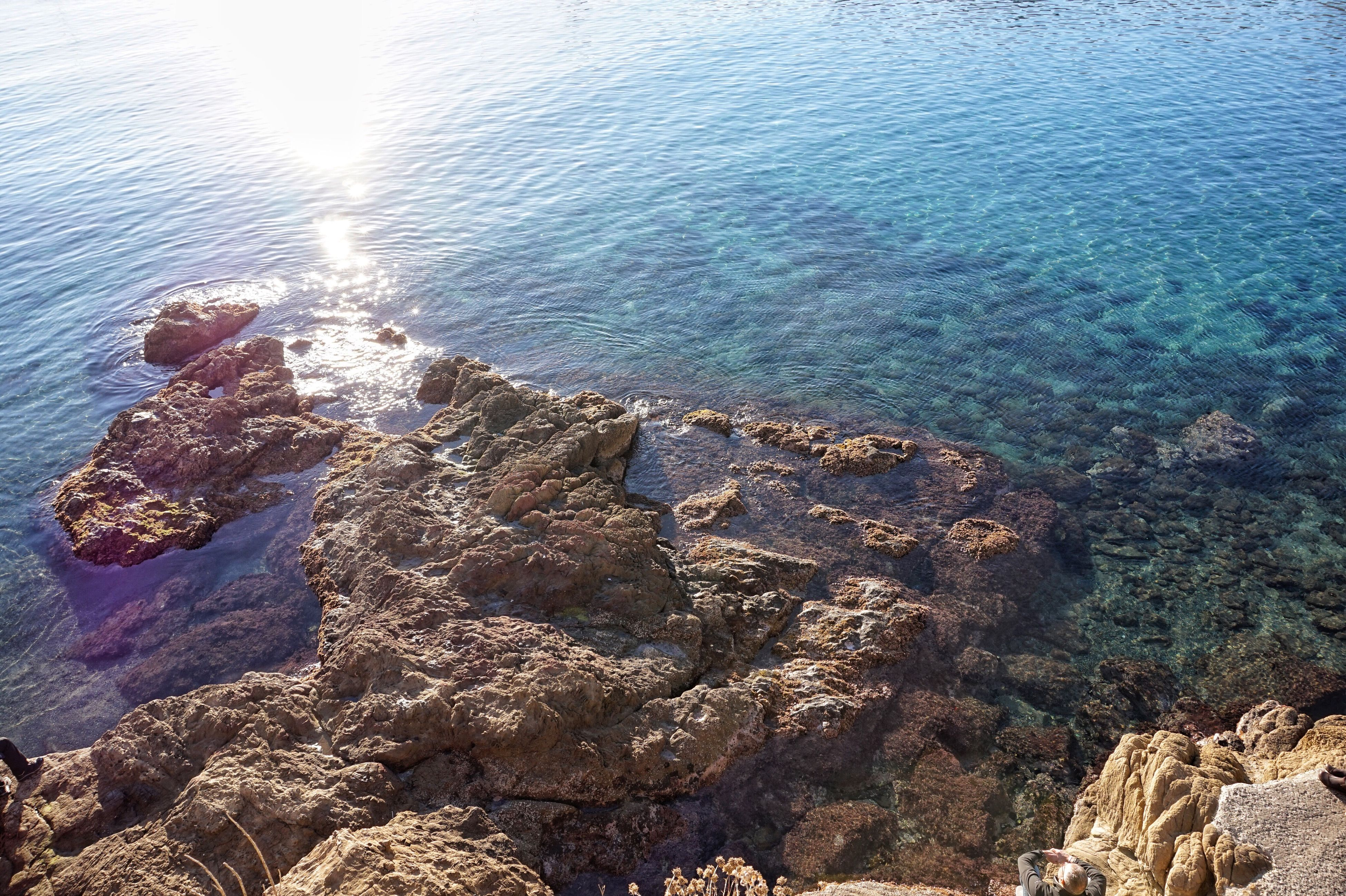 water, rock - object, sea, nature, sunlight, no people, day, high angle view, beauty in nature, outdoors, tranquility, tranquil scene, scenics, beach, sky