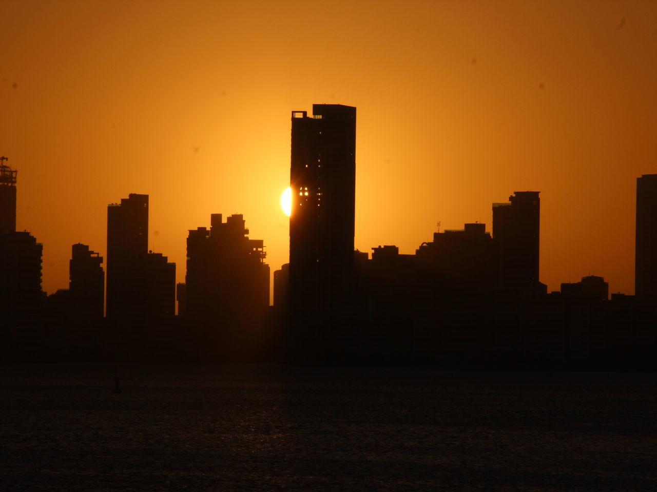 sunset, architecture, building exterior, silhouette, orange color, built structure, skyscraper, sun, sky, travel destinations, city, no people, outdoors, cityscape, urban skyline, beauty in nature, nature, growth, scenics