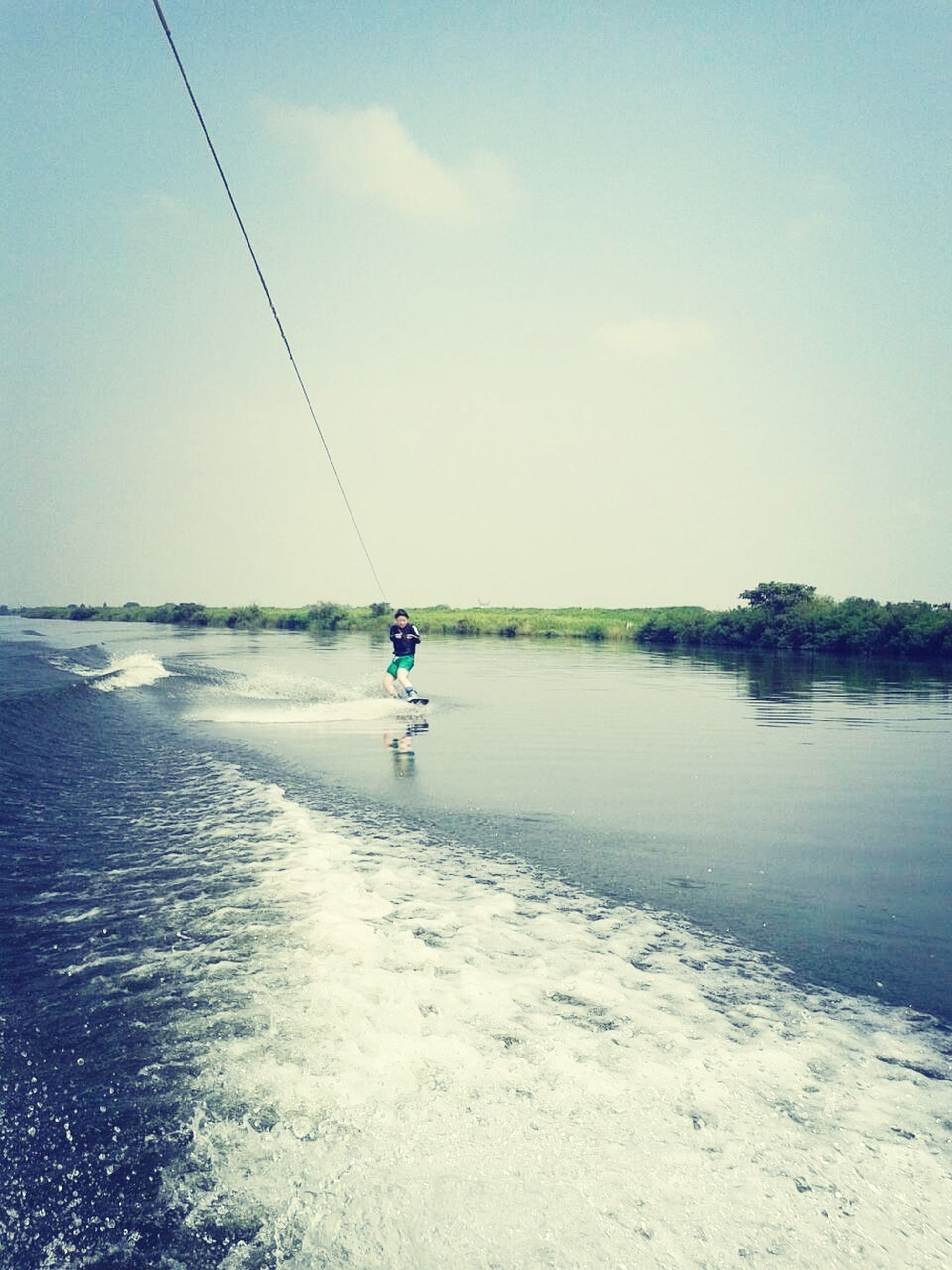 leisure activity, water, lifestyles, full length, sea, men, vacations, sky, extreme sports, adventure, beach, tranquility, scenics, nature, tranquil scene, enjoyment, beauty in nature, horizon over water
