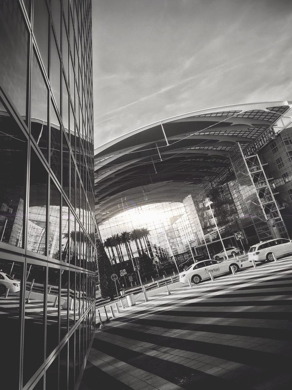 📐 Break The Mold Architecture City Built Structure Building Exterior Transportation Modern Skyscraper Outdoors Road City Life Day No People Sky Cityscape Monochrome Photography Tadaa Community Blackandwhite Blackandwhite Photography Iphonephotography Monochrome Shootermag Black & White Tadaa Friends B&w