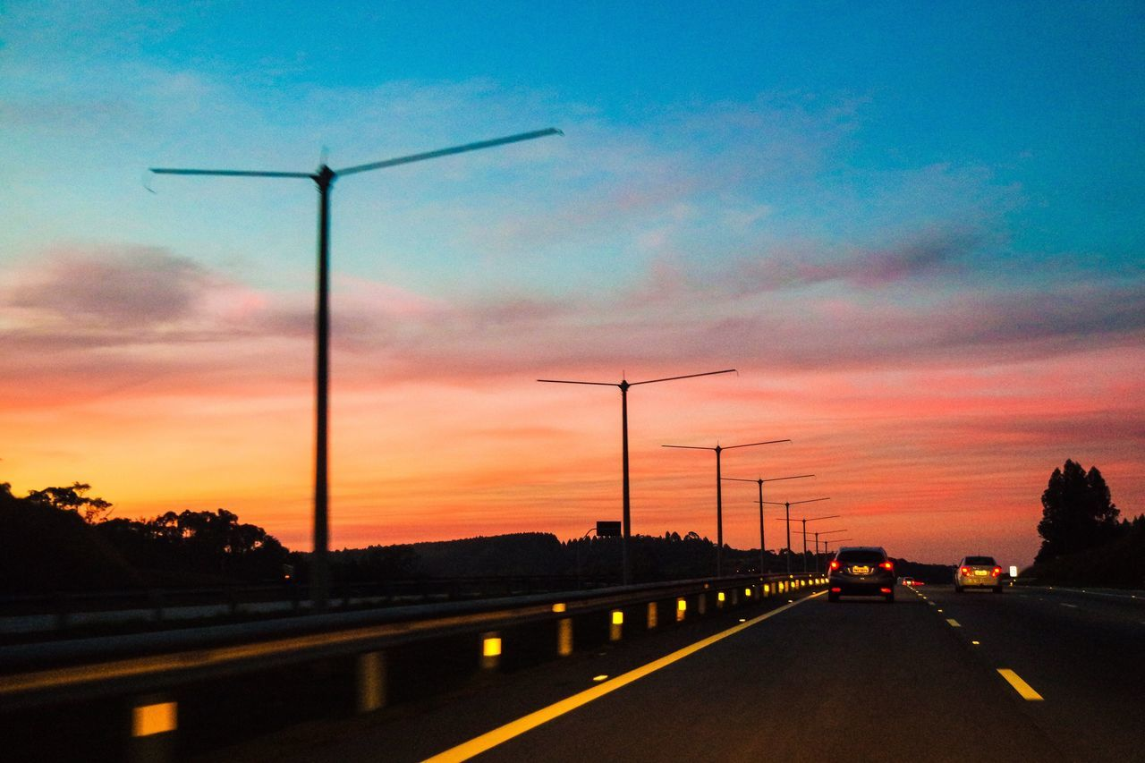 sunset, sky, environmental conservation, transportation, alternative energy, road, fuel and power generation, wind turbine, wind power, car, cloud - sky, no people, outdoors, street light, silhouette, nature, windmill, industrial windmill, day