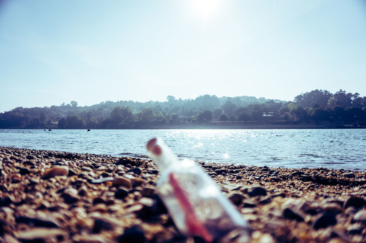 Beach Beauty In Nature Calm Clear Sky Coastline Day Message In A Bottle Nature Non-urban Scene Outdoors Remote Sand Sandy Scenics Seascape Secret Selective Focus Shore Sunlight Sunny Surface Level Tranquil Scene Tranquility Water