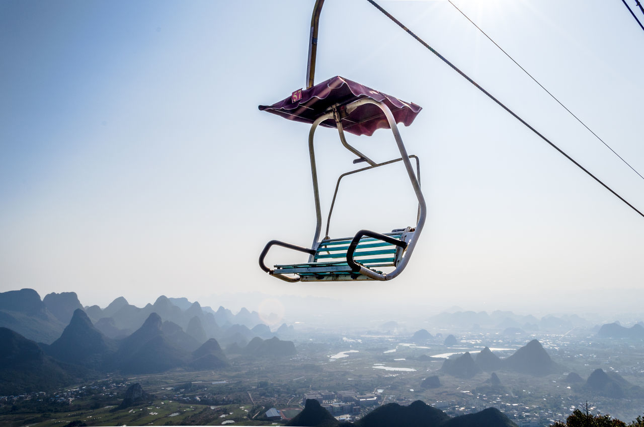Free seat available Cable Car day Hanging landscape mountain range Nature no people outdoors overhead cable car sky Sunny swing Traveling Home for the Holidays Fresh on Market 2017