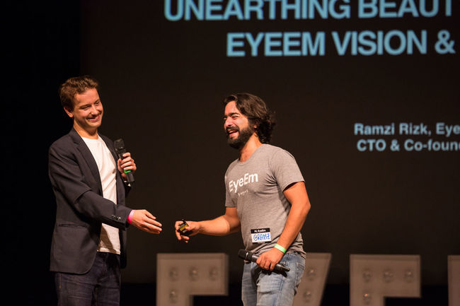 CTO Ramzi Rizk of EyeEm experiencing technical diffuculties during his presentation and seeking for help ;-) Casual Clothing Communication Conference Eyeemfestival16 Holding Indoors  Standing Text Western Script