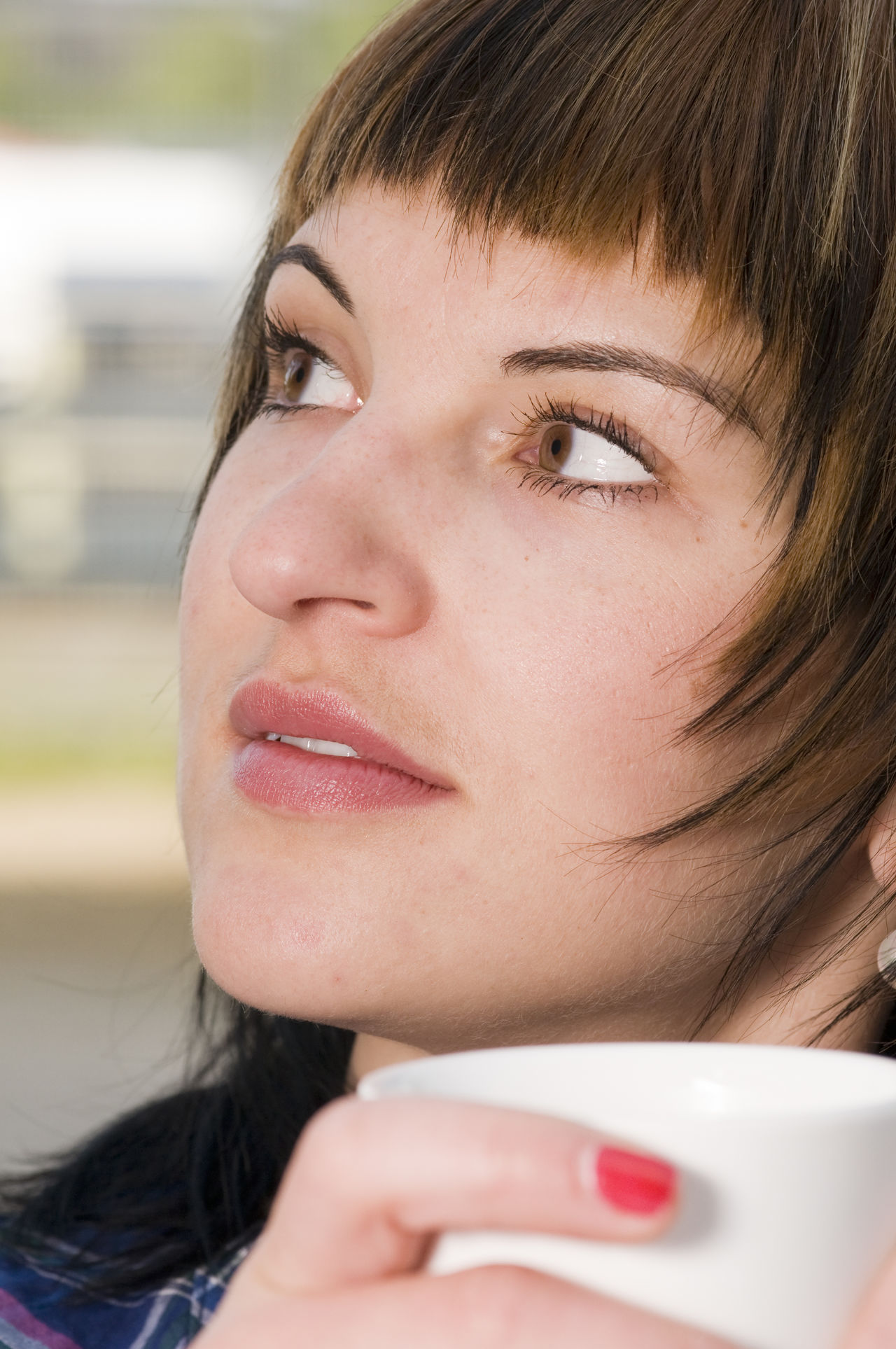 Close up of young woman dreamy side look with white Cup outdoor. Adult Adults Only Beautiful Woman Beauty Beauty In Nature Body Care Close-up Coffecup Cupcakes Day Dreamy Face Headshot Human Body Part Human Lips Look Away One Person One Woman Only One Young Woman Only Only Women Outdoors People Portrait Sidelook Young Adult