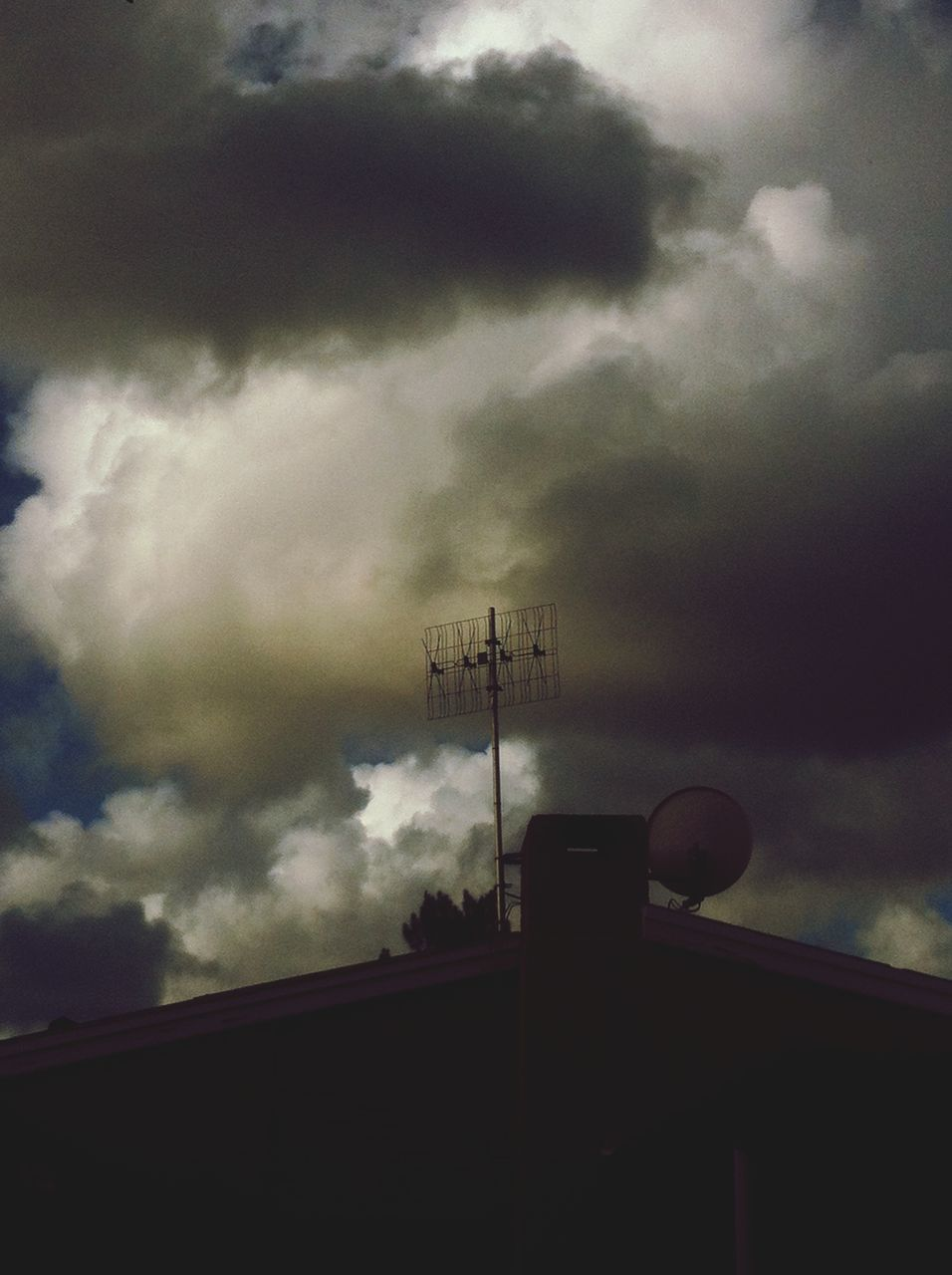 cloud - sky, sky, low angle view, communication, no people, connection, silhouette, technology, outdoors, storm cloud, day, architecture, nature, television aerial