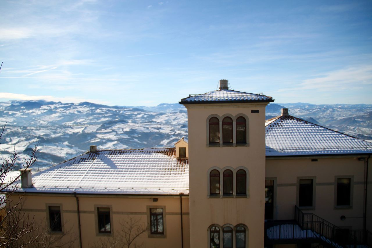 Architecture Building Exterior Built Structure Cold Temperature Day Europe Mountain Mountain Range Nature No People Outdoors Residential Building Roof San Marino Snow Travel Destinations Winter Winter Wintertime Monte Titano
