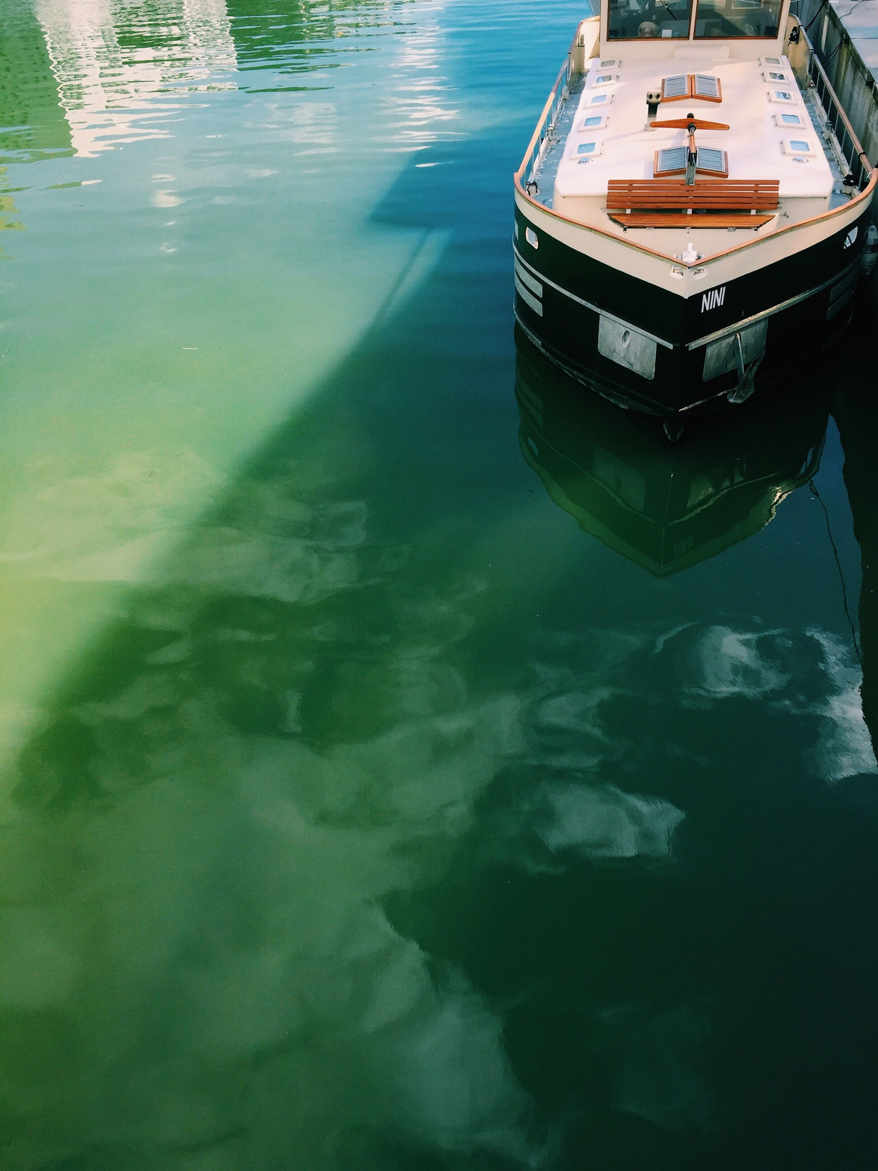 water, transportation, mode of transport, nautical vessel, boat, high angle view, waterfront, moored, reflection, sea, travel, river, outdoors, day, nature, rippled, sunlight, no people, on the move, lake