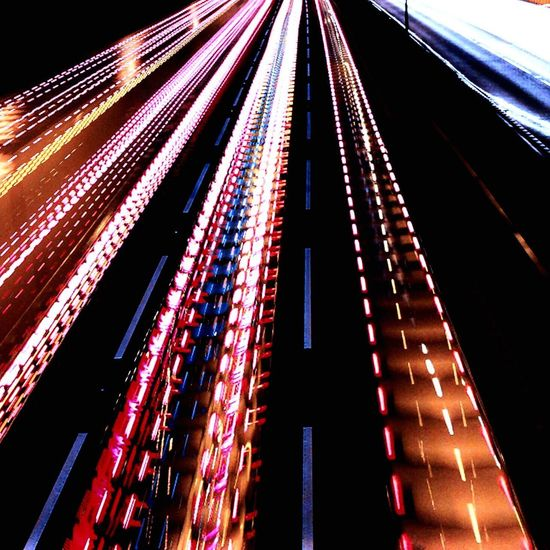 Illuminated Built Structure Low Angle View Architecture Red Multi Colored No People Night Outdoors City Traffic Car EyeEmNewHere Your Ticket To Europe The Week On EyeEm EyeEmNewHere Connected By Travel