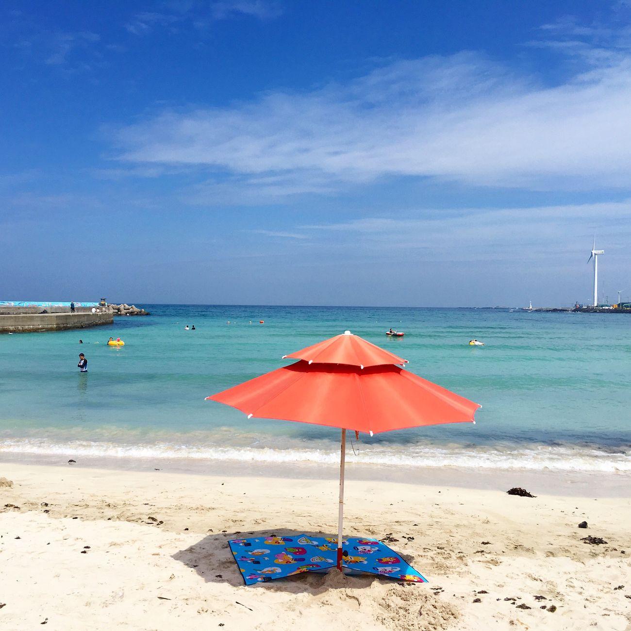 Jeju_korea Jejuisland Lifeisbetteratthebeach Jeju_beach Redumbrella