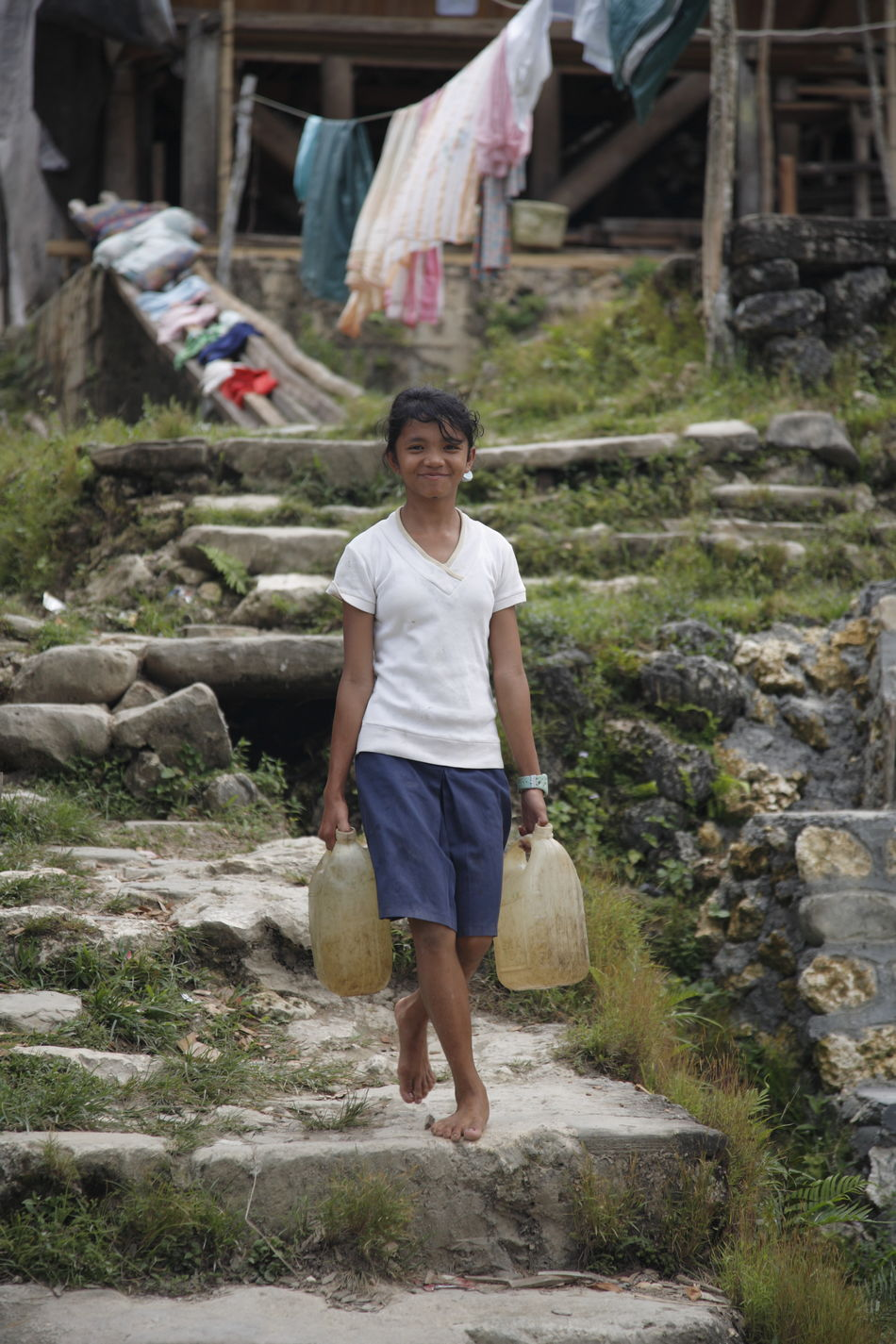 Uniqueness Real People Traditional Culture Child Childhood Child Worker Carrying Water  Nias Island INDONESIA Miles Away Women Around The World