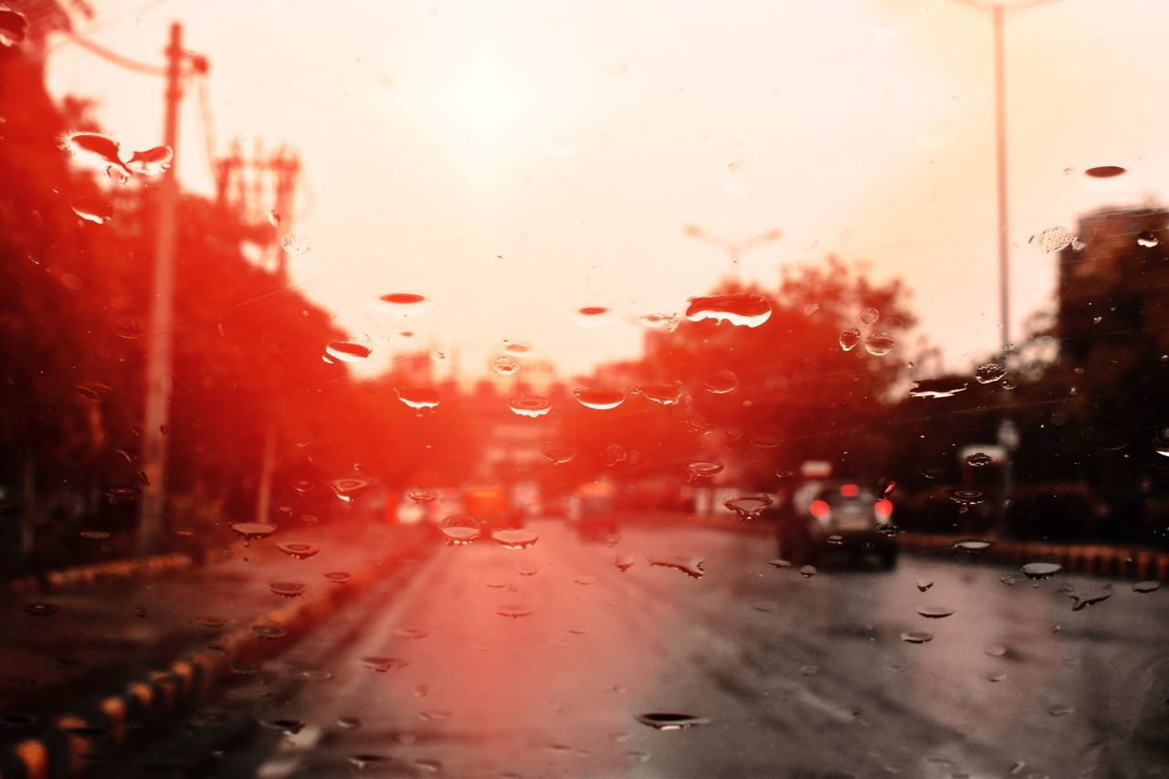 car, wet, drop, land vehicle, rain, glass - material, vehicle interior, raindrop, weather, water, rainy season, window, no people, transportation, mode of transport, car interior, road, windshield, red, indoors, looking through window, close-up, sky, day, nature