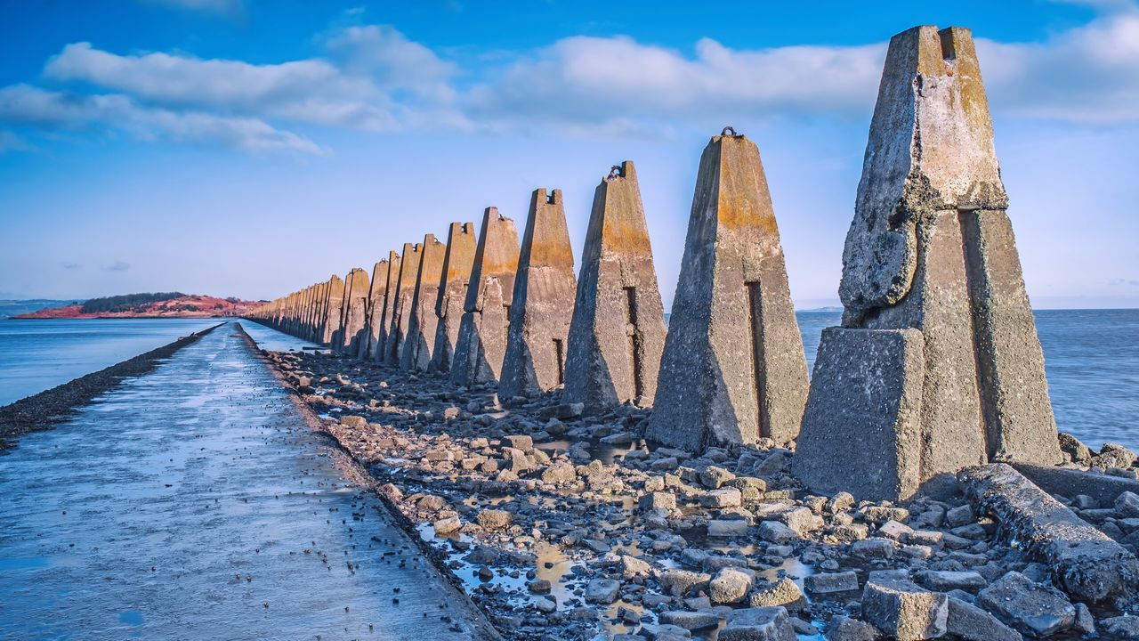 Cramond island walkway Edinburgh Cramond Cramondisland Scotland Seaside Sea Shore Water Sky Clouds Clouds And Sky Landscape Walkway Stone Concrete Pylons Antisubmarine Outdoors FirthOfForth