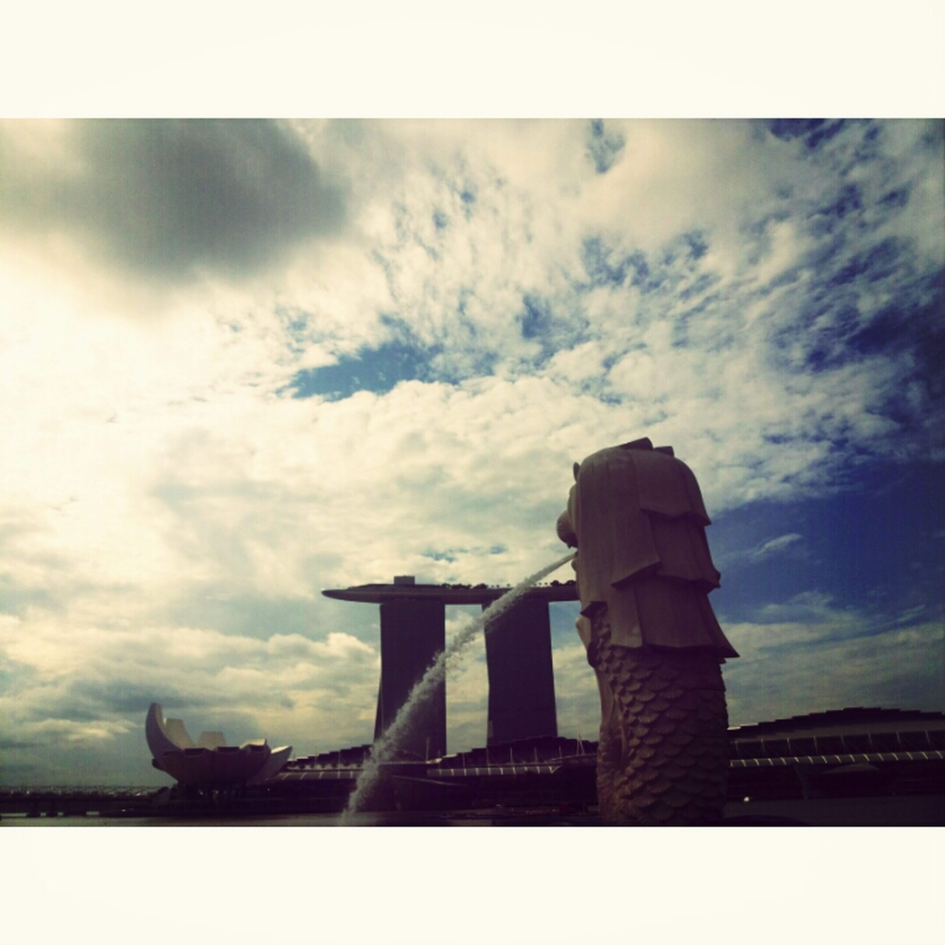 transfer print, sky, cloud - sky, architecture, built structure, cloudy, auto post production filter, silhouette, low angle view, cloud, building exterior, bridge - man made structure, water, connection, overcast, weather, outdoors, dusk, bridge, nature
