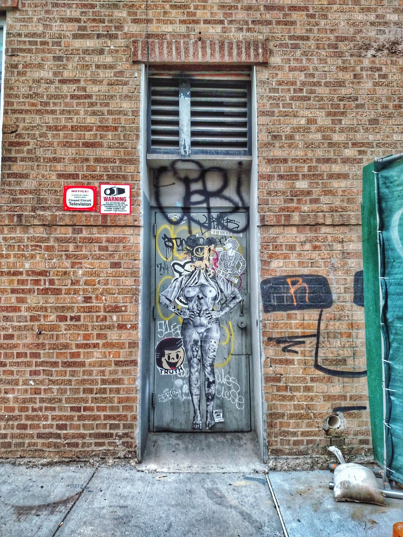 Architecture Built Structure Building Exterior Door No People Day Outdoors No Parking Sign Old Buildings Brick Wall City New York City Art NYC New York Graffiti Williamsburg Brooklyn Urban Urban Art Wall - Building Feature Wall Art Wall Wall Murals Door Finding New Frontiers