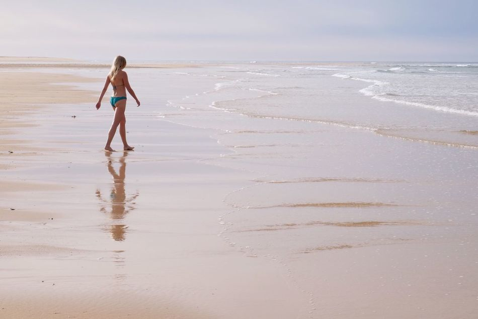 Sea Beach Water Sand Full Length Walking Nature Standing One Person Vacations Tranquility Tranquil Scene Scenics Beauty In Nature Outdoors Summer Horizon Over Water Woman Portrait Reflection EyeEm Best Shots Popular Photos in Praia De Faro Algarve , Portugal