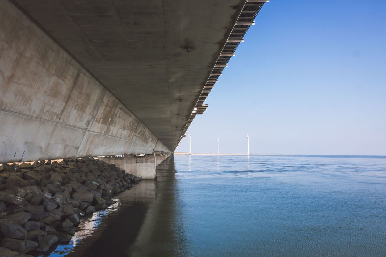 Alternative Energy Architecture Beauty In Nature Bridge - Man Made Structure Built Structure Connection Day Delta Works Deltawerken Fuel And Power Generation Horizon Over Water Nature No People Outdoors Sea Sky Underneath Water Wind Power Wind Turbine Windmill