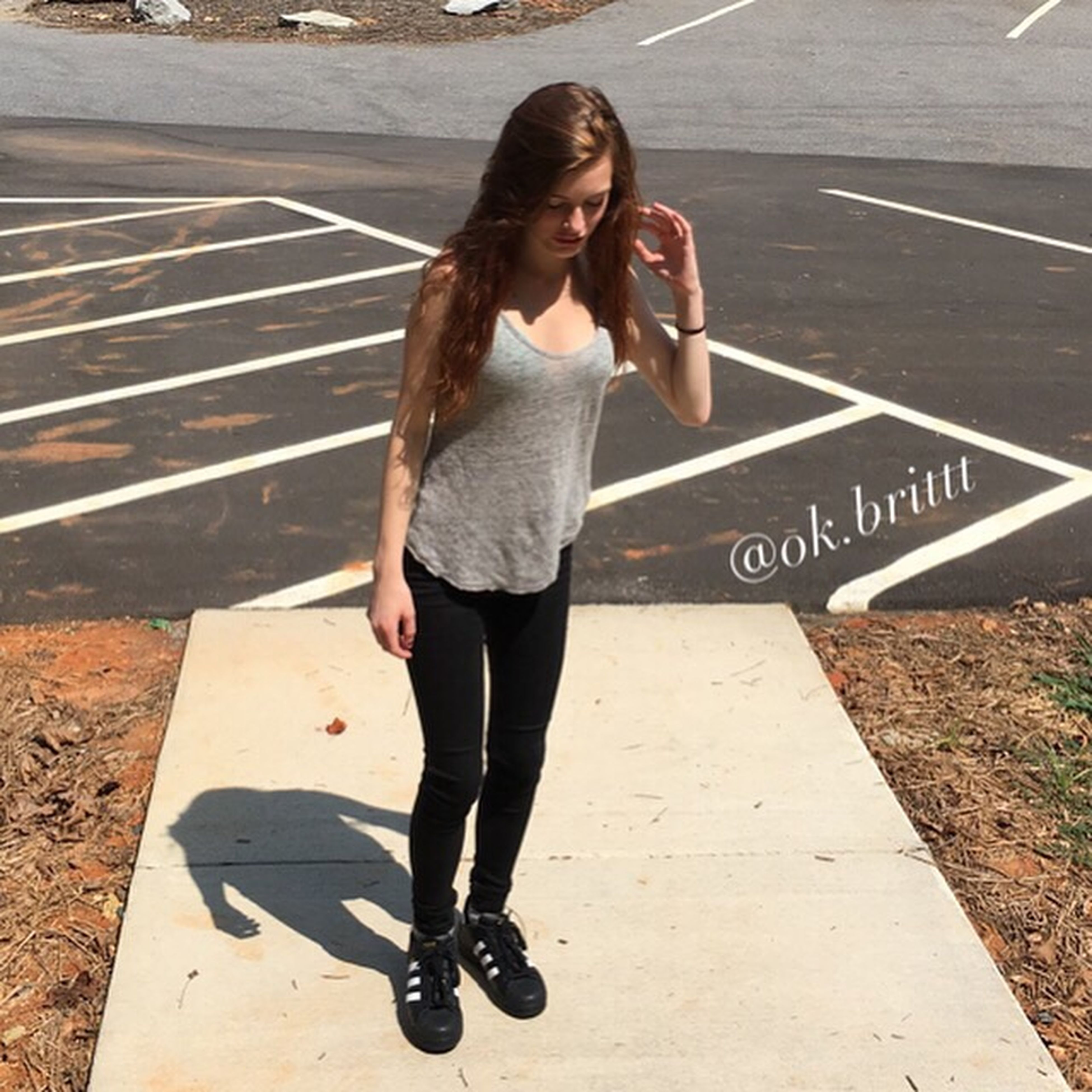 casual clothing, young women, full length, leisure activity, young adult, person, lifestyles, shadow, sunlight, long hair, standing, day, outdoors, sunny, medium-length hair, beauty, fashionable, top - garment
