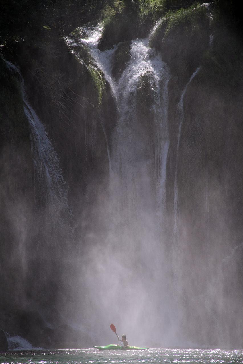Kayak Against Waterfall