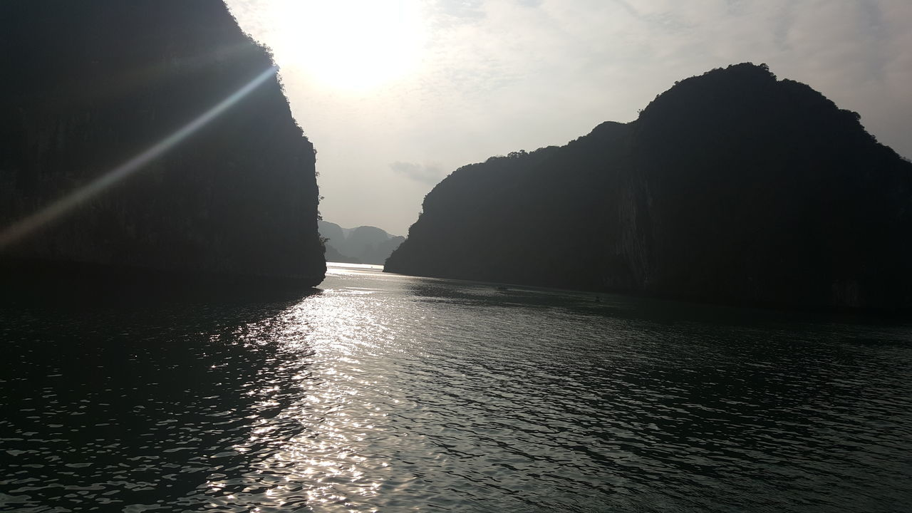 Halong Vietnam Tranquility Sky Relaxing Paradise Holiday Vietnamphotography Vietnam Trip Beauty Travel Beauty In Nature Asian  Greenery Green Water Tourism Cruise Cruising Sun Sun And Sea Calm Halongbay Halong Bay Vietnam Miles Away
