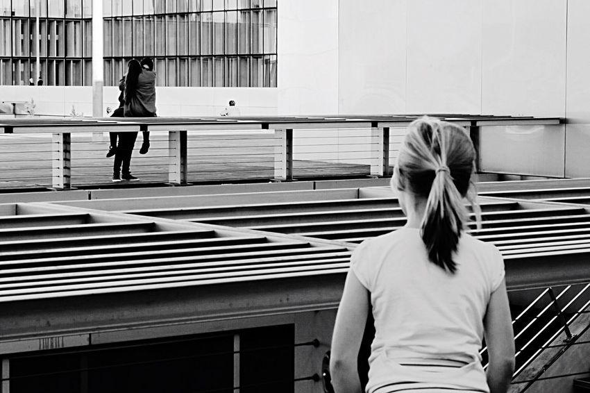 Love story. Monochrome Photography Composition Urban Streetphotography Black And White Blackandwhite Photography Blackandwhite Person Lovers City Life Lifestyles Street Photography Building Exterior Blak And White Side By Side TheWeekOnEyeEM Embrace Urban Life