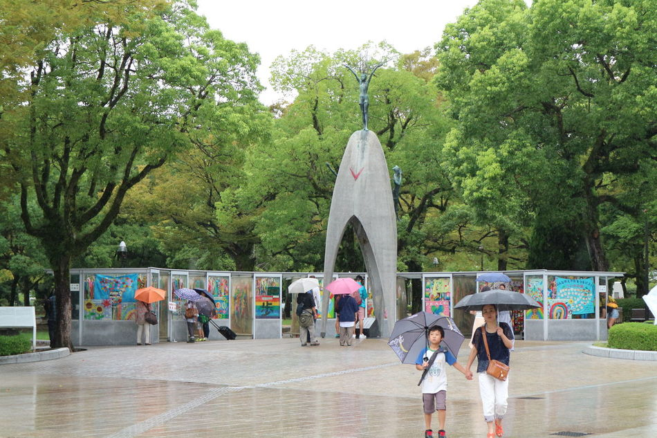 Woman and child at the Children's Peace Monument in Hiroshima Adult Capture The Moment Child Children Children's Peace Monument Crane Culture Day Hiroshima Japan Joy Monument Outdoors Paper Crane Peace People Respect Sorrow Tree Umbrella World Peace Young Women