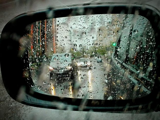 Raindrops Rain Raining Rear Wiew Rearviewmirror Rearview Mirror Reflections Rain Drops Drops Of Water Drops Lights On The Water Showcase April Different Perspective Different Angle Showing Imperfection Up Close Street Photography The Following Mein Automoment Fine Art Photography On The Way