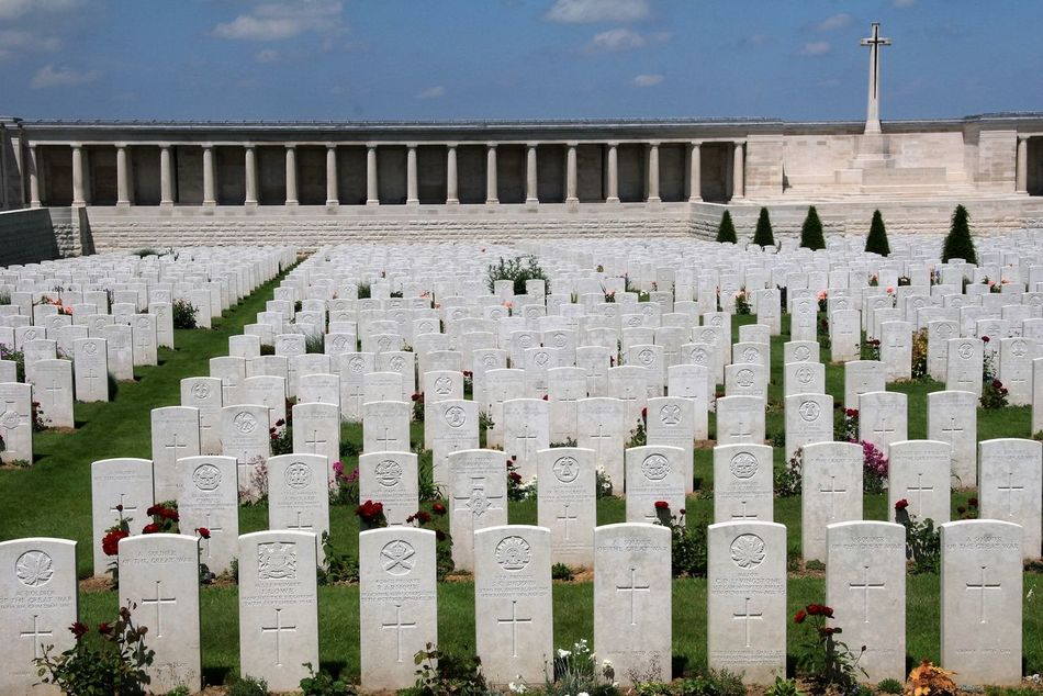 The British Cemetery and Pozieres Memorial is located on the D929 Albert-Bapaume road, just south of the village of Pozieres; and 6km north-east of Albert. The Pozieres Memorial's 97 panels contain the names of 14,655 UK and 300 South African missing soldiers who presumably lost their lives on the Somme battlefields between March 21st and August, 7th, 1918. The Pozieres British Cemetery contains over 2,700 marked graves within the boundary wall of the Pozieres Memorial. http://pics.travelnotes.org Albert Bapaume Battle Of The Somme Blue Sky British Cemetery Calm Commonwealth Commonwealth War Graves Commission Cross Europe France Gravestones Green Grass Memorial Michel Guntern Missing Soldiers No People Pozieres Pozieres British Cemetery Roses Serenity Somme Battlefields Travel War Graves White Stone