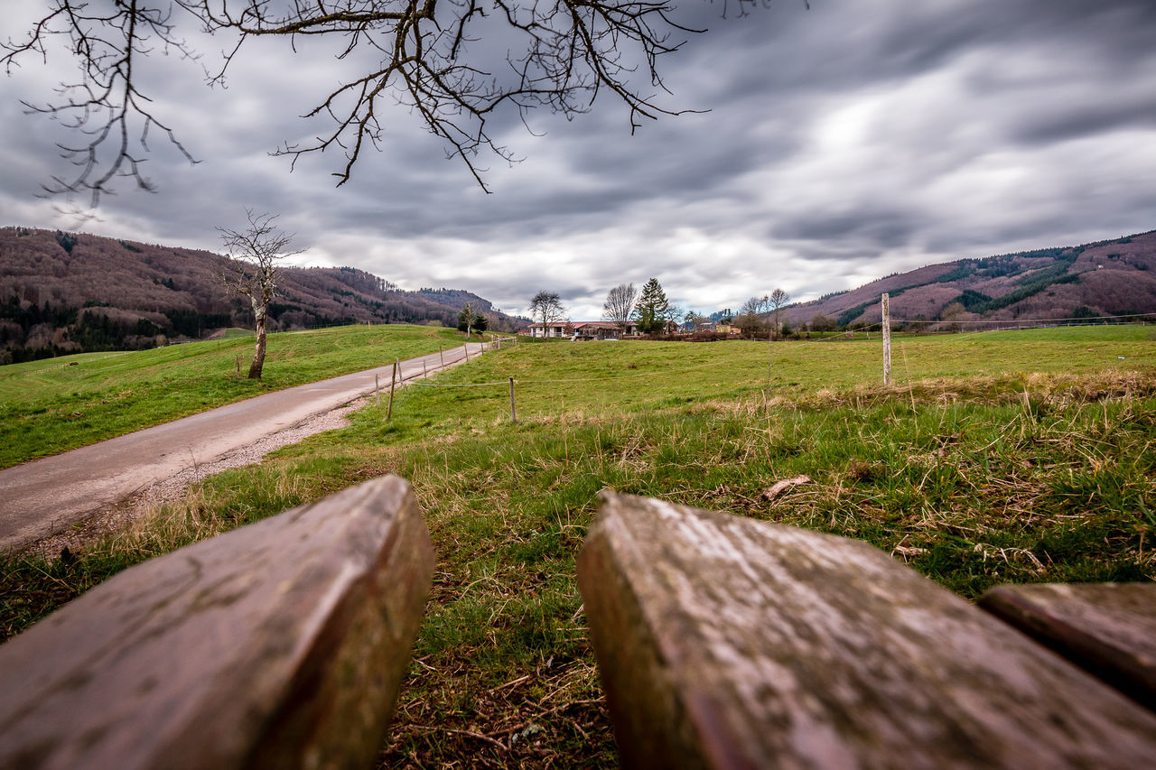 Blick von der Bank März 2016 Beauty In Nature Bench Cloud Cloud - Sky Cloudy Countryside Field Green Color Horizon Over Land Landscape Langzeitbelichtung Long Exposure Mountain Nature No People Outdoors Sky Tree Wood - Material