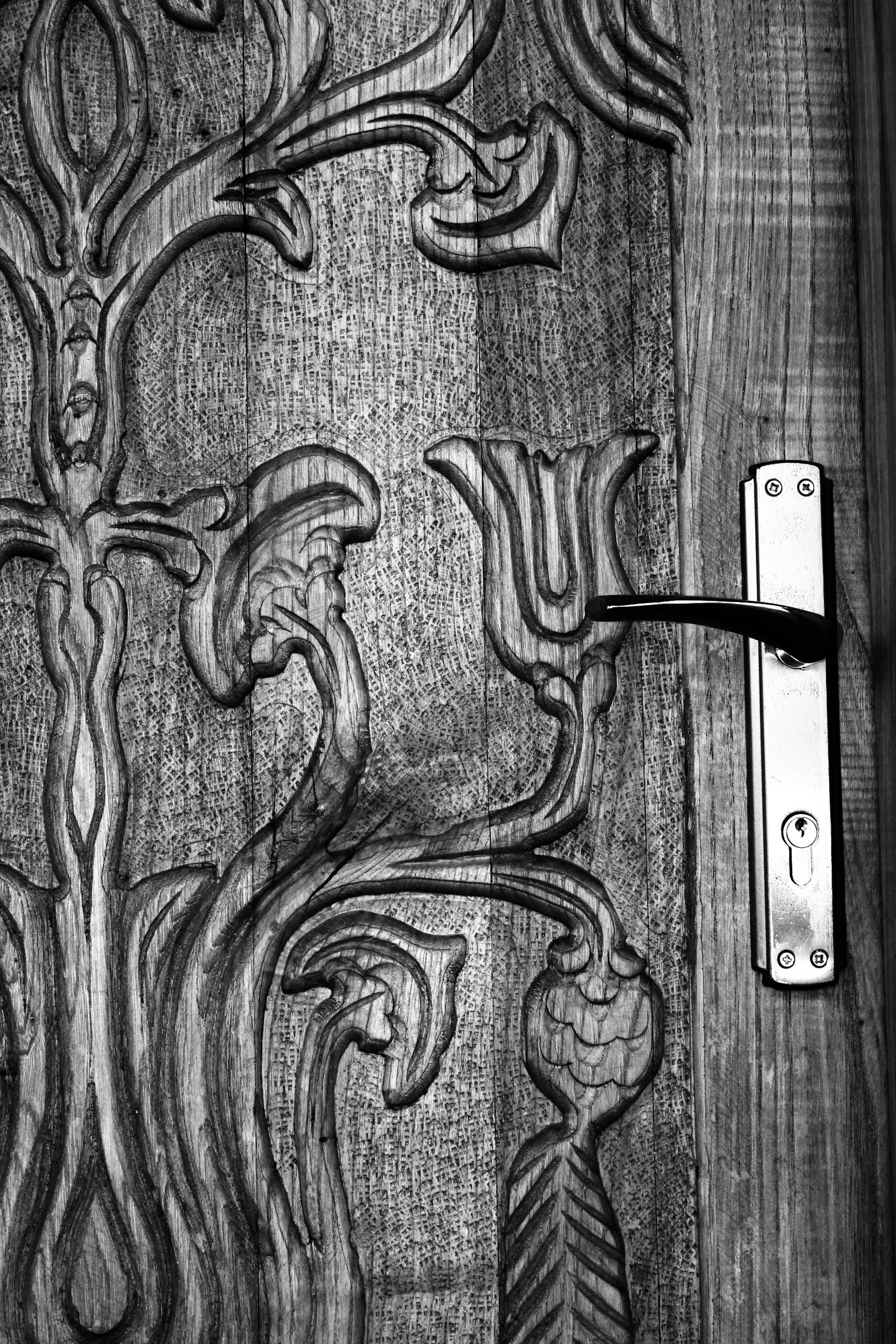 indoors, close-up, communication, art and craft, text, art, metal, wood - material, wall - building feature, creativity, western script, design, pattern, wooden, number, door, metallic, part of, no people, human representation