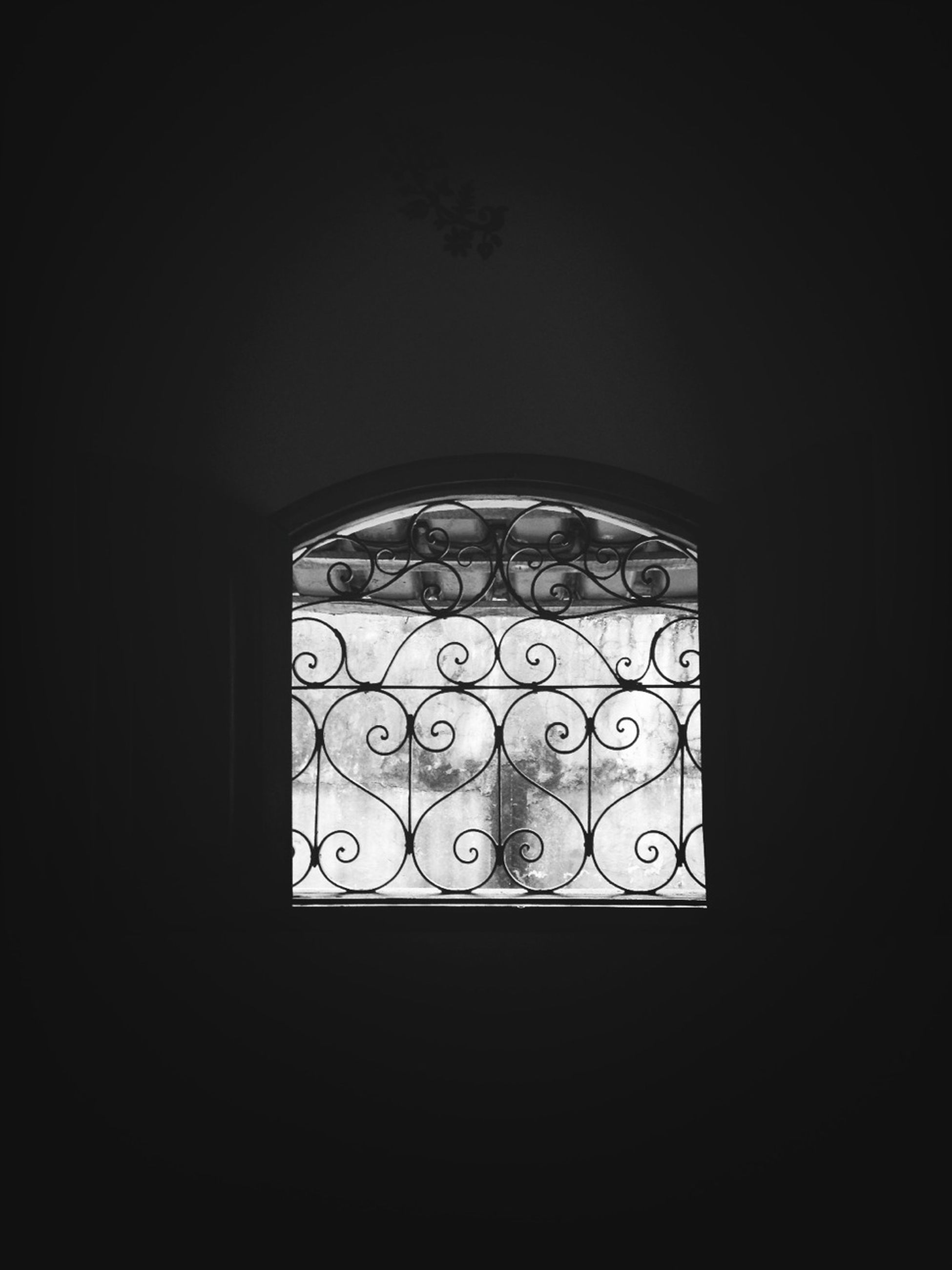 indoors, window, dark, design, built structure, pattern, architecture, copy space, arch, glass - material, closed, no people, stained glass, geometric shape, transparent, wall, wall - building feature, home interior, shape, door