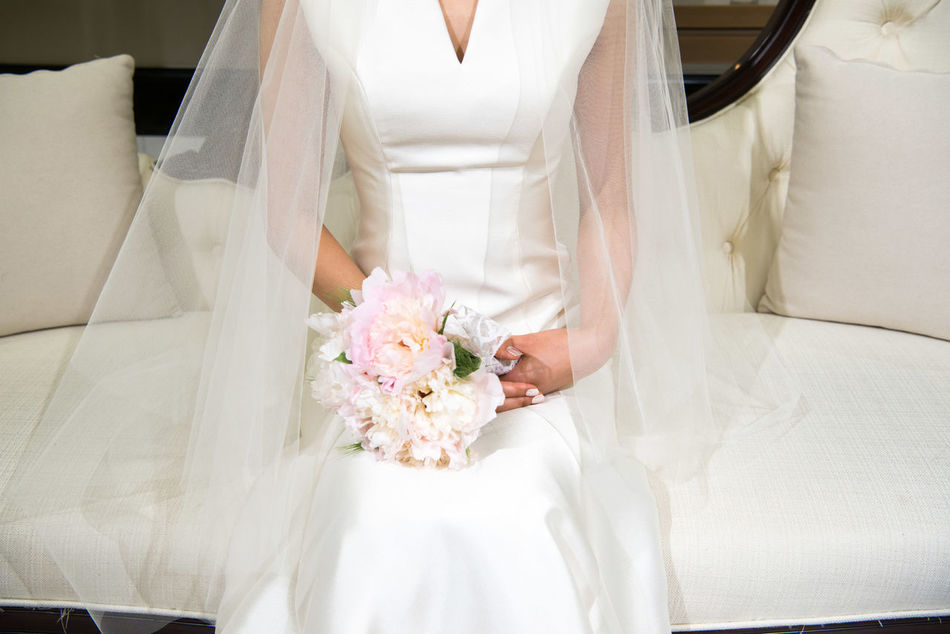 Adult Beginnings Bouquet Bride Bridegroom Celebration Celebration Event Ceremony Flower Holding Human Body Part Indoors  Life Events Married Midsection New Life One Person Sitting Wedding Wedding Ceremony Wedding Dress White Color Wife Women Young Adult