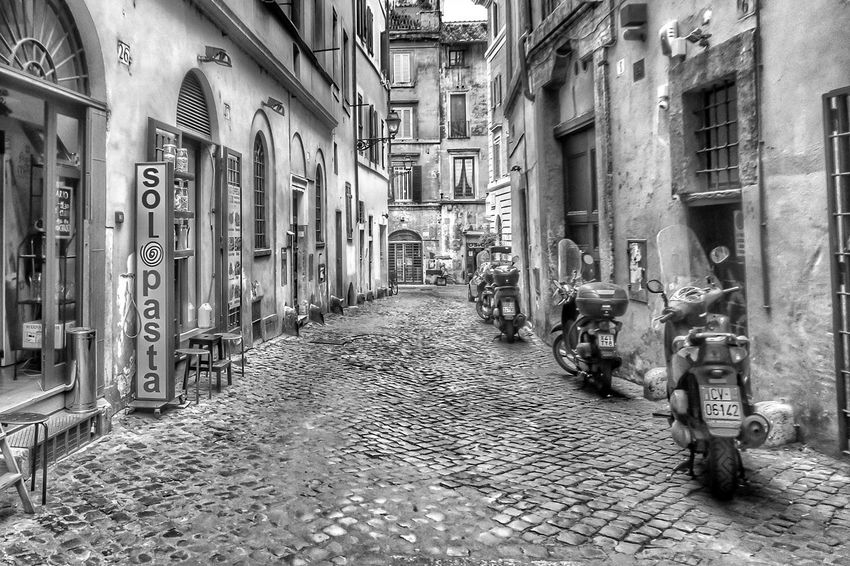 Solo pasta - Rome, Italy - 30 June 2017 The Way Forward Architecture Built Structure Building Exterior Day No People Outdoors City Traveling Roma Rome, Italy Rome Italia Blackandwhite Travel Italy Vacations Rome Italy Travel Destinations Streetphotography Tourist Destination Mopeds Travel Photography Street Photography Tourism
