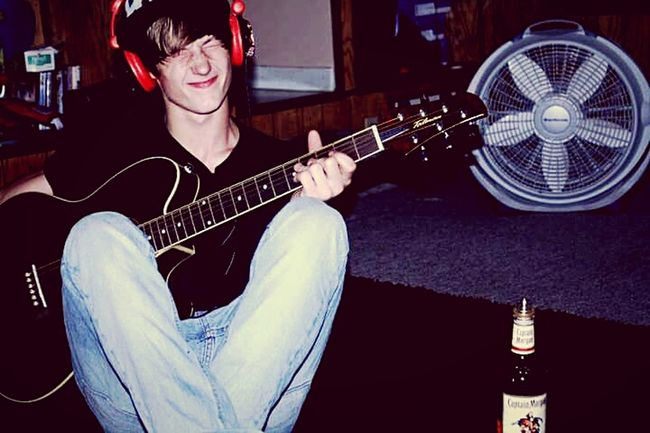 One Person Music Playing Guitar Electric Guitar Indoors  Musical Instrument Guitarist Jackdaniels Portrait Headphones On  Life Lifestyles Nightlife Real People Young Adult Arts Culture And Entertainment