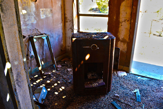 I'm Still Here Abandoned Absence Arizona Bad Condition Broken Damaged Day Deterioration Dirty Empty Falling Apart Forgotten Furniture Garbage Messy No People Obsolete Old Open Picture Frame Run-down Rust Rusty Sun Light Wood - Material