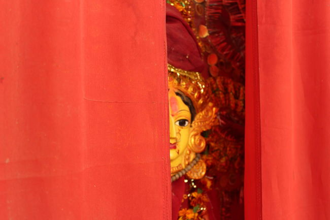 Goddess Peeking from behind the Curtains, a Temple in Varanasi No Effects