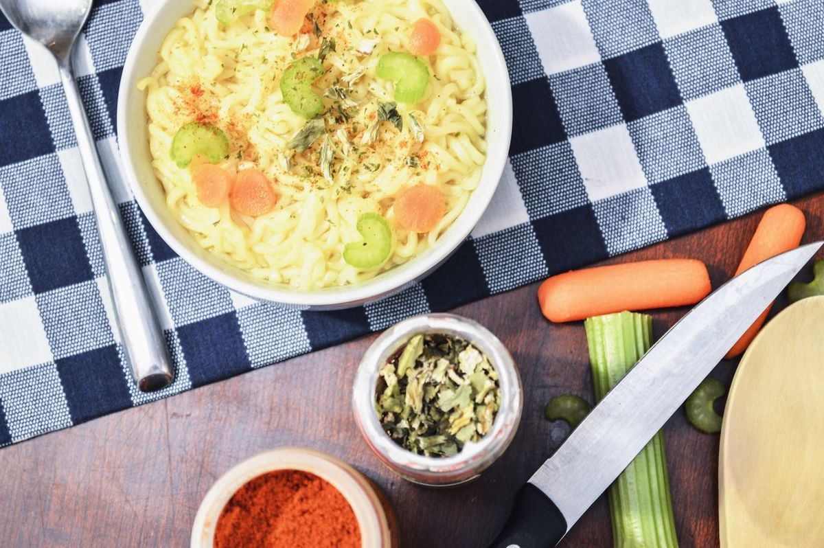 Warming up with a bowl of chicken noodle soup High Angle View Freshness Bowl Food And Drink Directly Above Healthy Eating Fork Ready-to-eat Tablecloth Kitchen Knife Vegetable Food Indoors  No People Table Salad Bowl Close-up Dish Towel Chive Day Soup Chicken Noodle Soup Bowl Of Soup Plaid Flatlay
