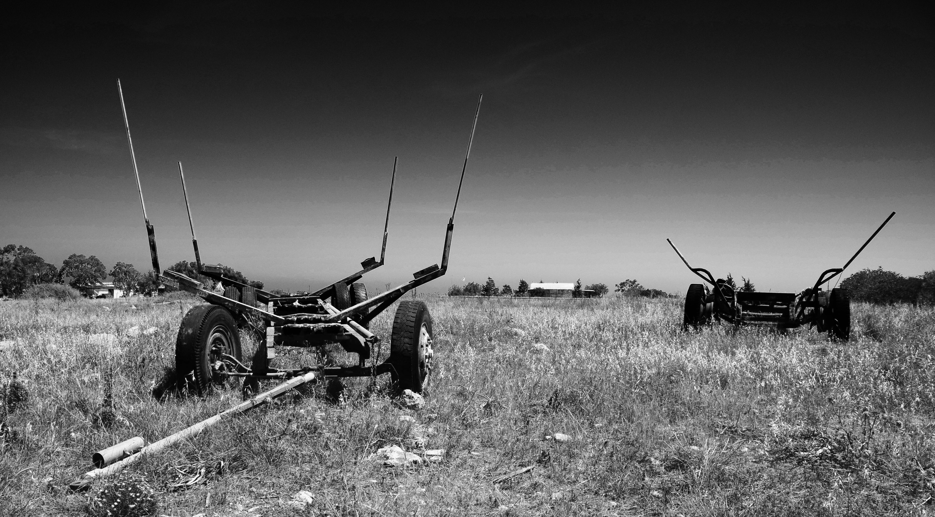 field, transportation, mode of transport, grass, abandoned, landscape, clear sky, damaged, land vehicle, sky, rural scene, nature, obsolete, tranquility, grassy, copy space, outdoors, tranquil scene, day, non-urban scene