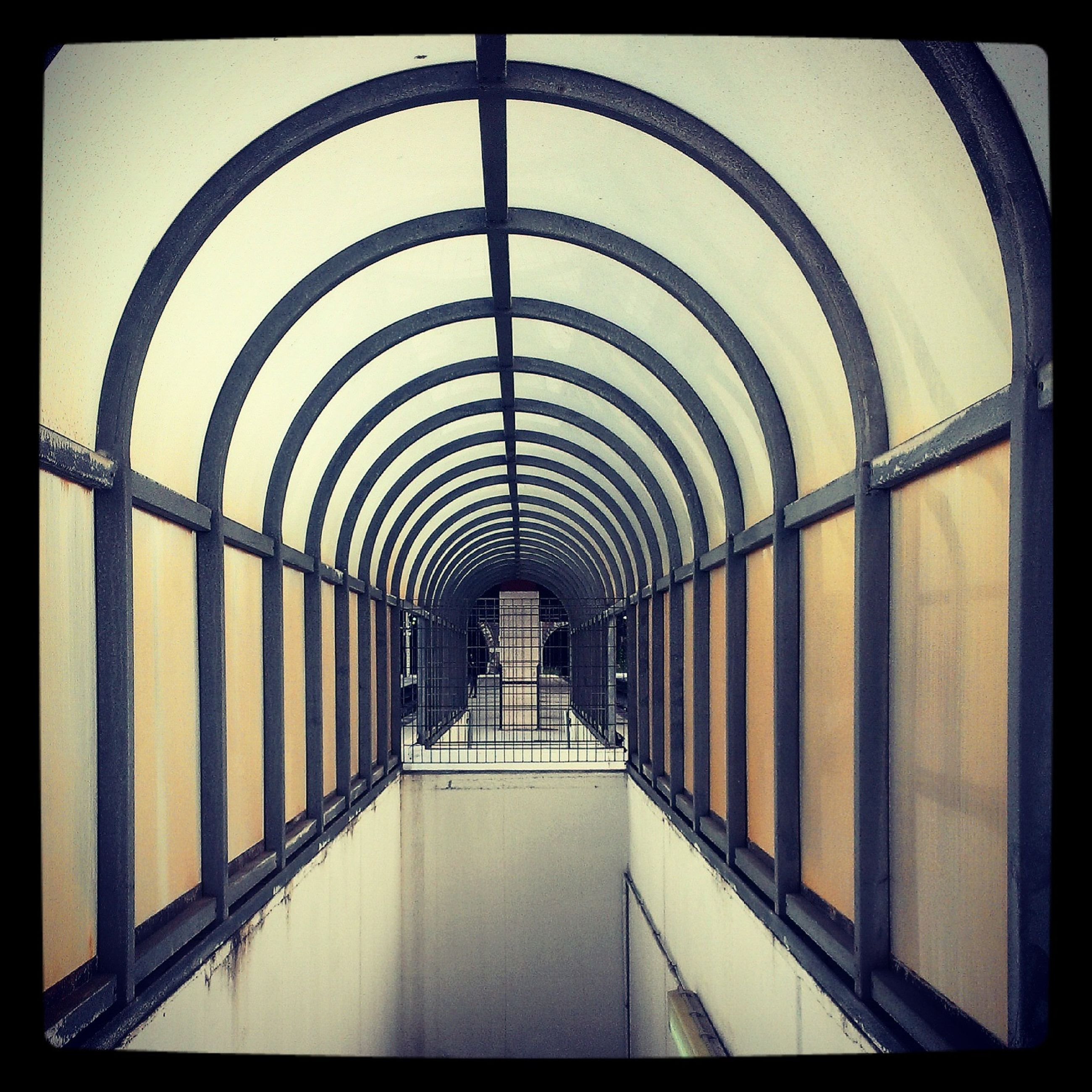architecture, built structure, transfer print, indoors, the way forward, diminishing perspective, arch, auto post production filter, railing, vanishing point, corridor, ceiling, pattern, day, architectural feature, architectural column, column, in a row, no people, building exterior