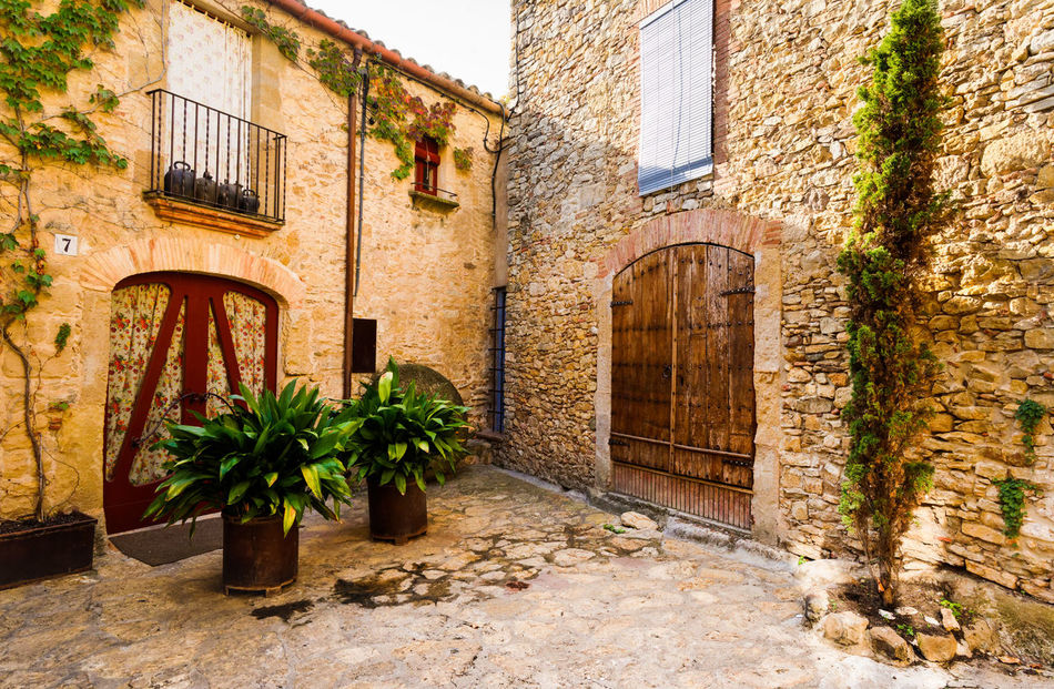 "Peratallada - ""Carved Stone' Architecture Balcony Brick Building Brick Wall Catalonia Cottage Country Life Countryside Courtyard  Curtains Doorway Lifestyles Medieval Architecture MedievalTown Mediterranean  Old Village Peratallada Plants Shadows & Lights SPAIN Travel Travel Destinations Travel Photography Traveling"