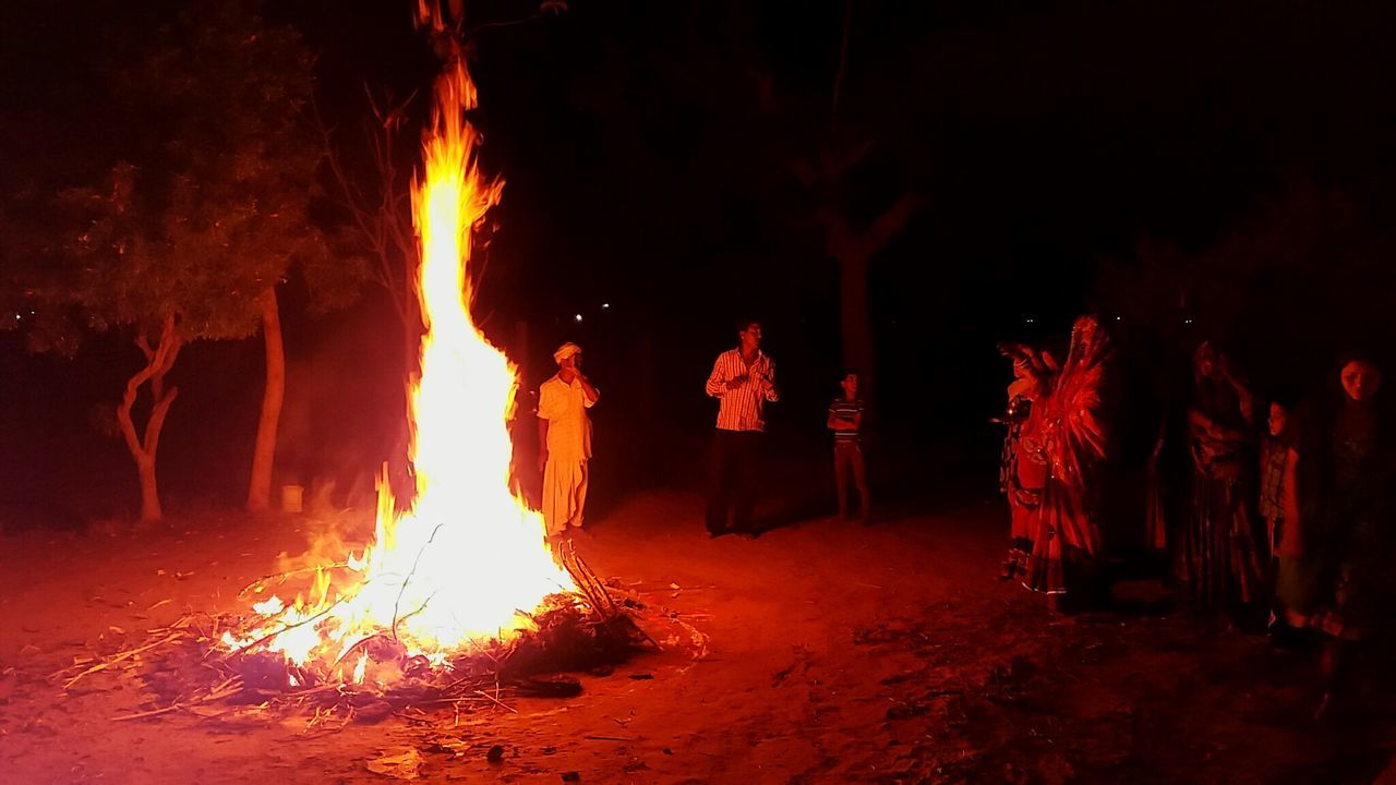 burning, flame, night, glowing, heat - temperature, bonfire, men, outdoors, campfire, real people, tree, togetherness, illuminated, sky, people